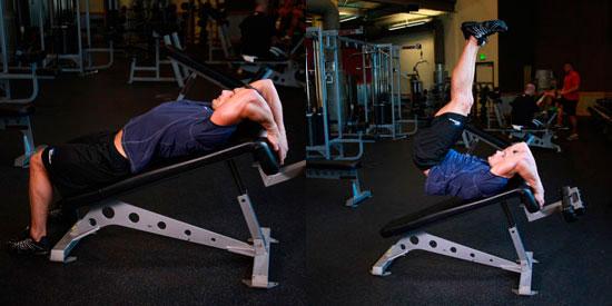 Подъём ног лёжа на наклонной скамье